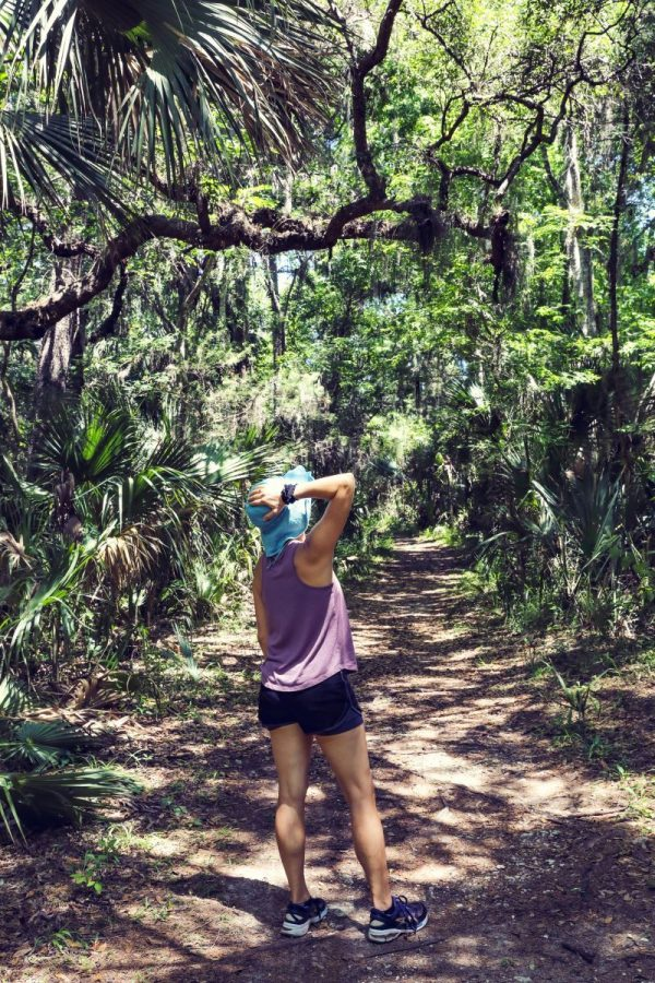 woman walking down a st augustine nature trail