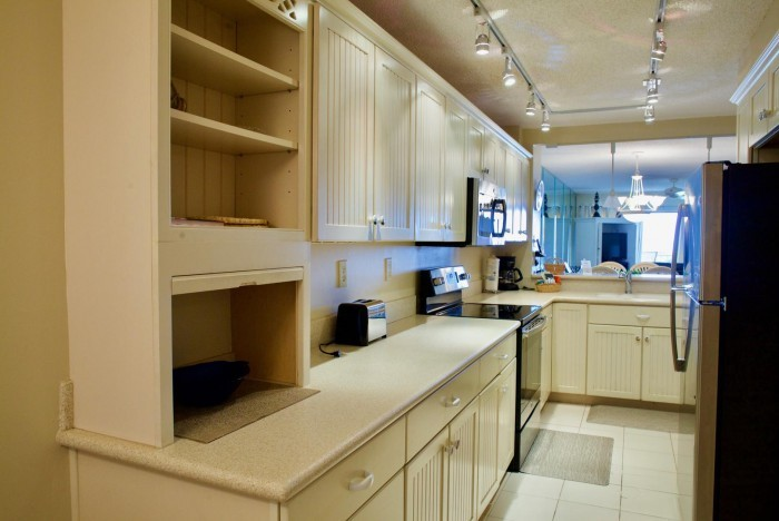 Interior of newly renovated condo kitchen in St. Augustine with white counter tops and cabinets