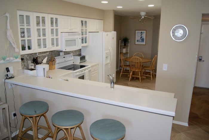 Interior of small kitchen and bar centrally located in the center of the condo in St. Augustine