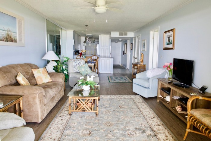 Open and airy view of the living room and kitchen in this St. Augustine Oceanfront Condo