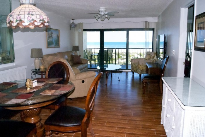 Interior of dining and living room with a view of the ocean from this St. Augustine condo